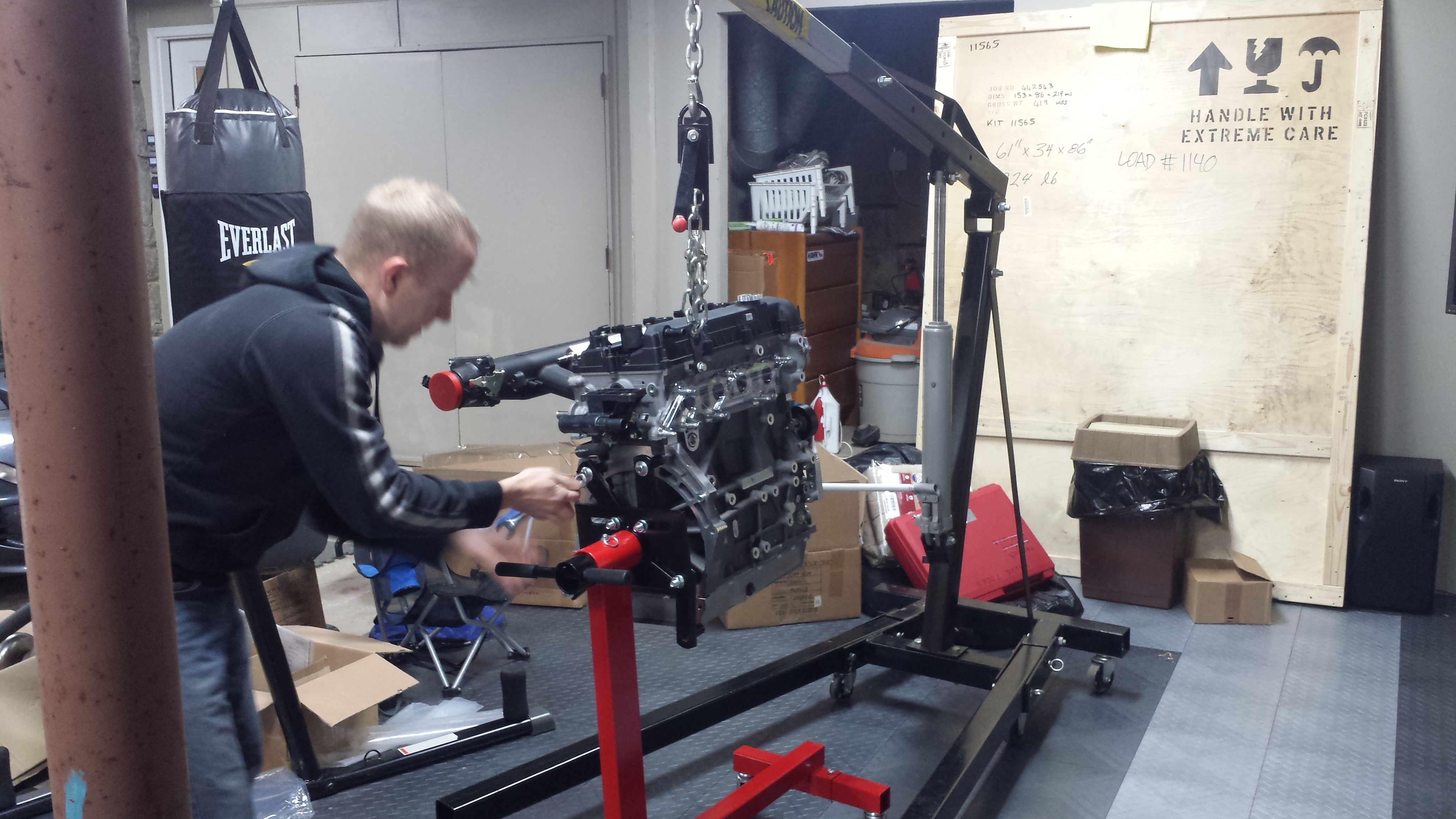 Engine coming off the stand
